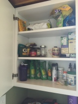 There are provided plates and cutlery that I've not stored in here yet, but this is more than enough pantry space!